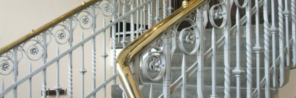 Wrought iron and brass staircase restoration